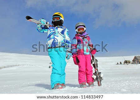 Girls with ski on the snow