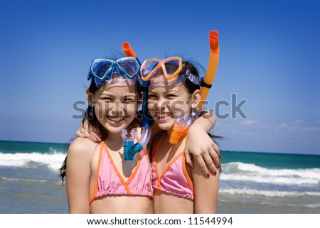 Girls with snorkel at the beach