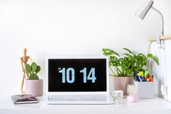 Girly home office / student room desk setup with white laptop and plants, mockup, quarantine