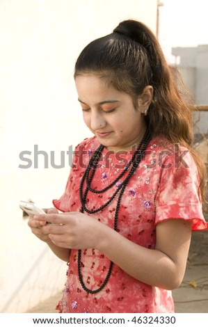 Girt checking sms on cell phone - stock photo