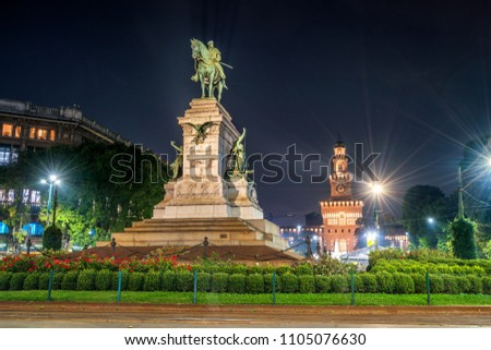 Giuseppe Garibaldi Monument in Milan, Italy and Sforza Castle (Castello Sforzesco) at night. They is the famous travel destination for tourist visiting Milan, Italy.