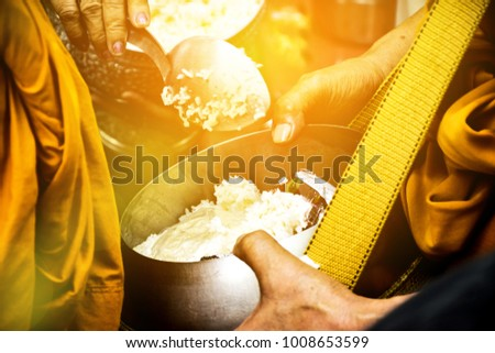 Give Food To The Monks. Give Alms To The Monks. Offerings In A Monk's Alms Bowl. People Give Alms To A Buddhist Monk In Morning, Thailand. Image For Graphic,Banners,Presentations,Reports,Wallpaper.