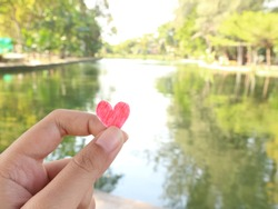 give heart with hand to nature