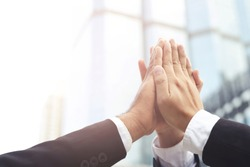 Give me five your clap hands articulate group businessman for good business team. concept Success and encouragement to overcome and overcame obstacles business solution strategy.