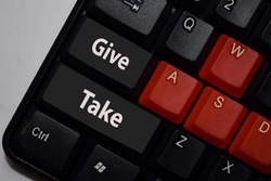 Give or Take isolated on laptop keyboard background. Bargaining or Bartering concept