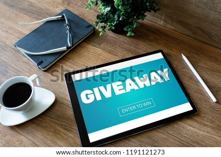 Giveaway, enter to win text on screen. Lottery and prizes. Social media marketing and advertising concept. #1191121273