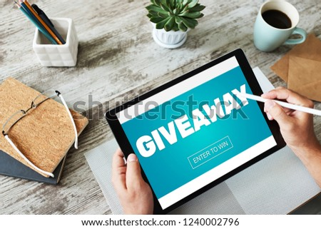 Giveaway, enter to win text on screen. Lottery and prizes. Social media marketing and advertising concept. #1240002796