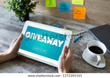 Giveaway, enter to win text on screen. Lottery and prizes. Social media marketing and advertising concept. #1372285565