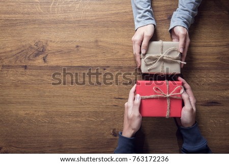 Gives a gift Christmas and new year presents laid on a wooden table background, copy space.