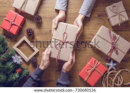 Gives a gift Christmas presents laid on a wooden table decoration background. Xmas concept.
