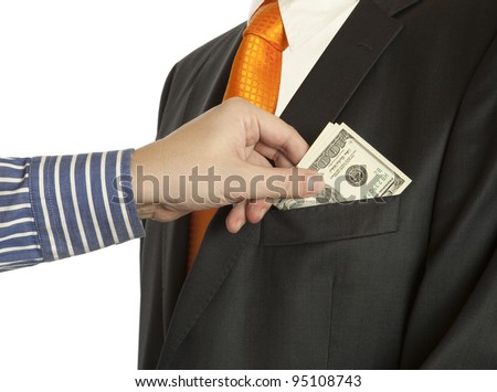 Giving a bribe into a pocket, horizontal shot  (Dollar banknotes)