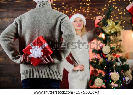 Giving and sharing. Winter surprise. Man carry gift box behind back defocused background. Christmas surprise concept. Surprising his wife. Surprise effect. Generosity and kindness. Prepare surprise.