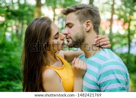Giving kiss. Seduction and foreplay. Sensual kiss of lovely couple close up. Couple in love kissing with passion outdoors. Man and woman attractive lovers romantic kiss. Passionate kiss concept.