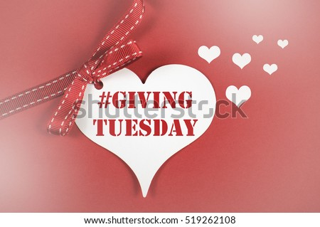 Giving Tuesday philanthropy day after Black Friday shopping message sign white heart on red background, with applied faded filters.  #519262108