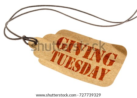 Giving Tuesday sign - a paper price tag with a twine isolated on white #727739329