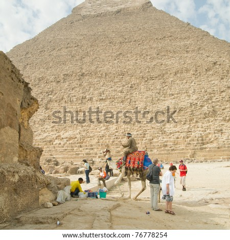 GIZA, EGYPT - NOV 15:  Tourist views the Pyramids by ride on a camel on November 15, 2010, at Giza, Egypt.  The world's oldest tourist attraction, the Pyramids of Giza are nearly 5000 years old.