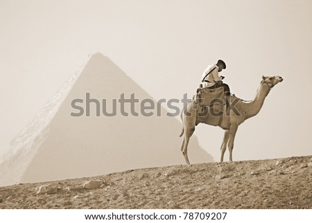 GIZA, EGYPT - NOV 15: Uniformed Tourist Police patrols the Pyramids on November 15, 2009, at Giza, Egypt. The world's oldest tourist attraction, the Pyramids of Giza are nearly 5000 years old.