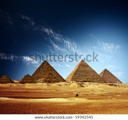Stock Photo Giza valley with Great pyramids and blue sky with clouds