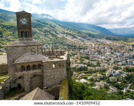 gjirokastra city in south albania. the most unique and tradional city with unique architechture. in the photo you can see the clock tower in the argjiro castle and the city in the background