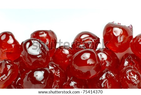 Glace cherries border; isolated against white background