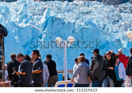 GLACIER BAY, AK - JUNE 1:  Passengers on deck of cruise ship looking at Marjorie Glacier in Glacier Bay National Park, one of the few glacier you can view as close as 1,000 feet, on June 1, 2009.