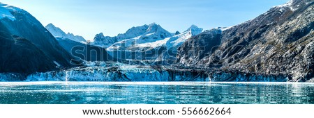 Glacier Bay, Alaska banner landscape from cruise ship cruising towards Johns Hopkins Glacier in summer in Alaska, USA. Banner panorama view. #556662664