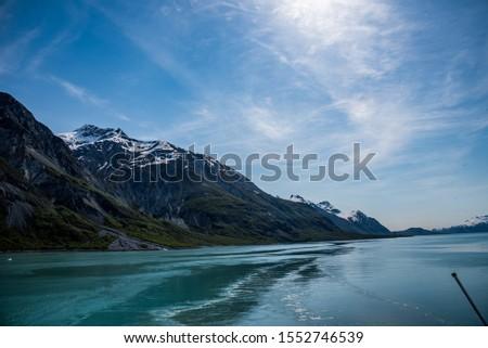Glacier Bay Alaska Glacier and Mountains Beautiful Scenic View Blue Skies White Glaciers  #1552746539