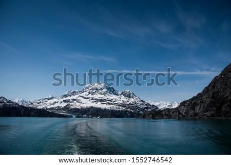 Glacier Bay Alaska Glacier and Mountains Beautiful Scenic View Blue Skies White Glaciers  #1552746542