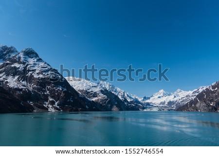 Glacier Bay Alaska Glacier and Mountains Beautiful Scenic View Blue Skies White Glaciers  #1552746554