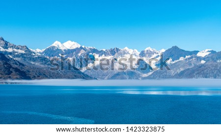 Glacier Bay National Park, Alaska. Spectacular sweeping vista of ice capped/ snow covered mountains, glaciers, wildlife landscape. Absolutely breathtaking natural untouched serene nature views. #1423323875