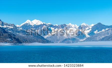 Glacier Bay National Park, Alaska. Spectacular sweeping vista of ice capped/ snow covered mountains, glaciers, wildlife landscape. Absolutely breathtaking natural untouched serene nature views. #1423323884