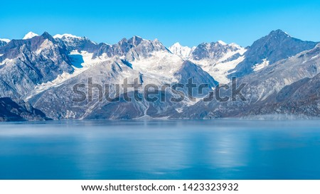 Glacier Bay National Park, Alaska. Spectacular sweeping vista of ice capped/ snow covered mountains, glaciers, wildlife landscape. Absolutely breathtaking natural untouched serene nature views. #1423323932