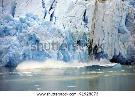 Glacier calving,Sawyer Glacier,Endicott Arm Fjord,Alaska - stock photo