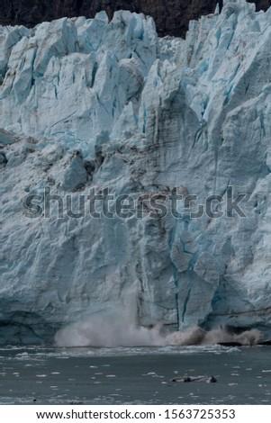 Glacier falling in Glacier Bay Alaska #1563725353