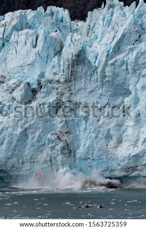 Glacier falling in Glacier Bay Alaska #1563725359