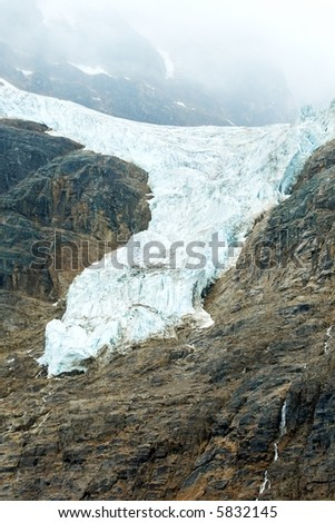 glacier ice frozen water mountain foggy misty jasper alberta canada - stock photo