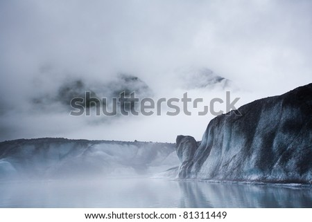 Glacier iceberg in the mist in Alaska