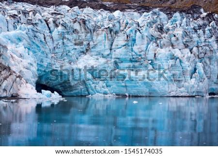 Glacier in Glacier Bay Alaska showing blue colours in the ice #1545174035