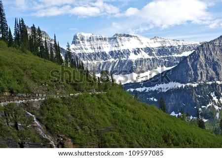 Glacier Mountains - Montana, USA. Road-To-The-Sun - Glacier National Park. Beautiful Mountain Scenery. Snowy Summits and Green Grassy Hills. Nature Photography Collection.