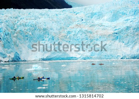 Glacier Sea Kayaking, another great way to explore beautiful blue glacier. Adventurous and fun activity for explorers #1315814702