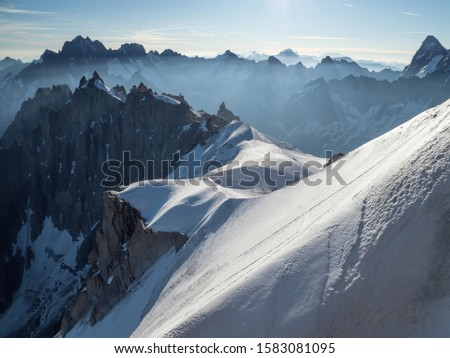 Glacier trail from Aiguille du Midi peak with peak of Mt. Blanc Massif, Chamonix, France