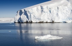 Glaciers and icebergs of Antarctic Peninsula. Travel on deep pure waters among ices of Antarctica. Fantastic snow landscapes.