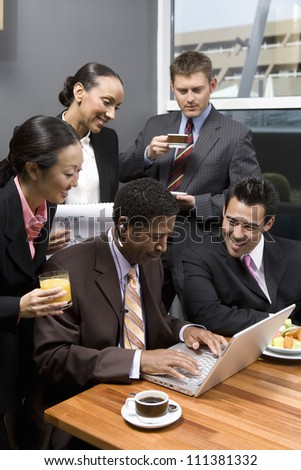Glad business people having discussion during their break