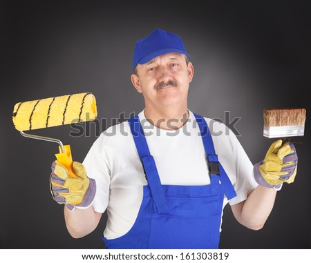 glad house painter against black background
