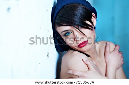 Glamor Portrait of sexy woman on blue background