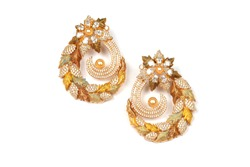 Glamorous antique Golden pair of earrings on white background. Luxury female jewelry, Indian traditional jewellery, kundan earring,Bridal Gold earrings wedding jewellery,Vintage earrings