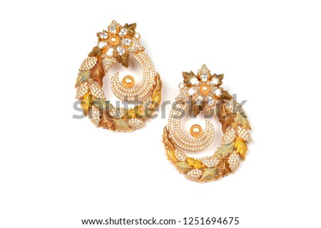 Glamorous antique Golden pair of earrings on white background. Luxury female jewelry, Indian traditional jewellery, kundan earring,Bridal Gold earrings wedding jewellery,Vintage earrings