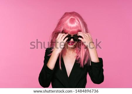 Glamorous charming woman pink hair dark glasses party model model #1484896736