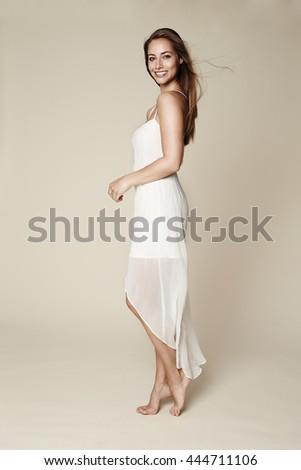 Glamorous girl in white dress, portrait
