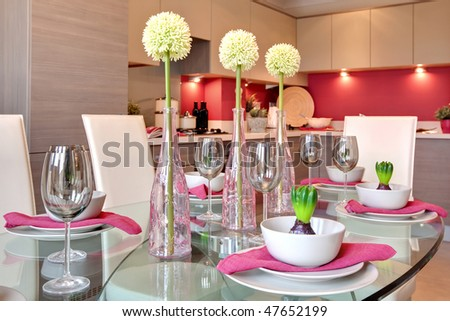 glamorous table setting ready for dinner party with kitchen background